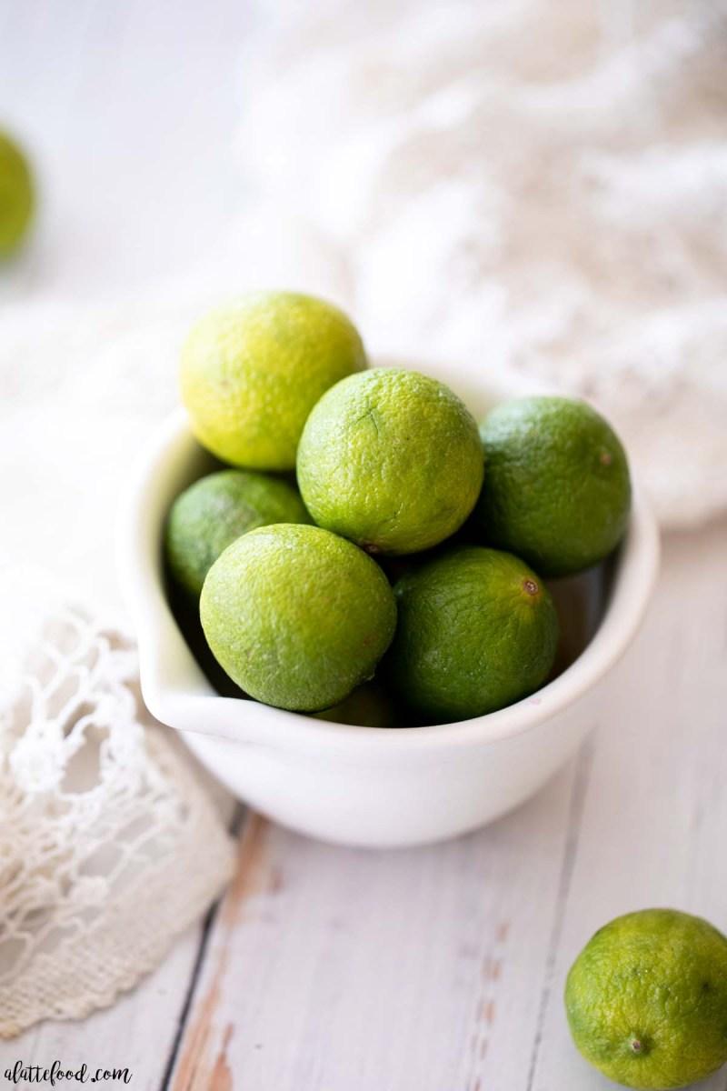 key limes in white bowl