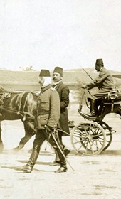 "Jäckh103: ""Commander-in-chief, General Shefket Torgut Pasha (wearing a wrap around his head) in Shkodra. In front of him is the retired Grand Vizier, Hilmi Pasha"" (Photo: Ernst Jäckh, ca. 1910. Courtesy of Rare Books and Manuscript Library, Columbia University, New York, 130114-0032)."
