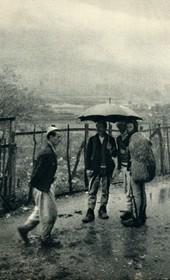 GM032: Men in Boga standing in the rain (Photo: Giuseppe Massani, 1940).