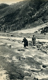 GM051: Father Anton Kiri being carried over the Shala River, with Giuseppe Massani behind him (Photo: Giuseppe Massani, 1940).