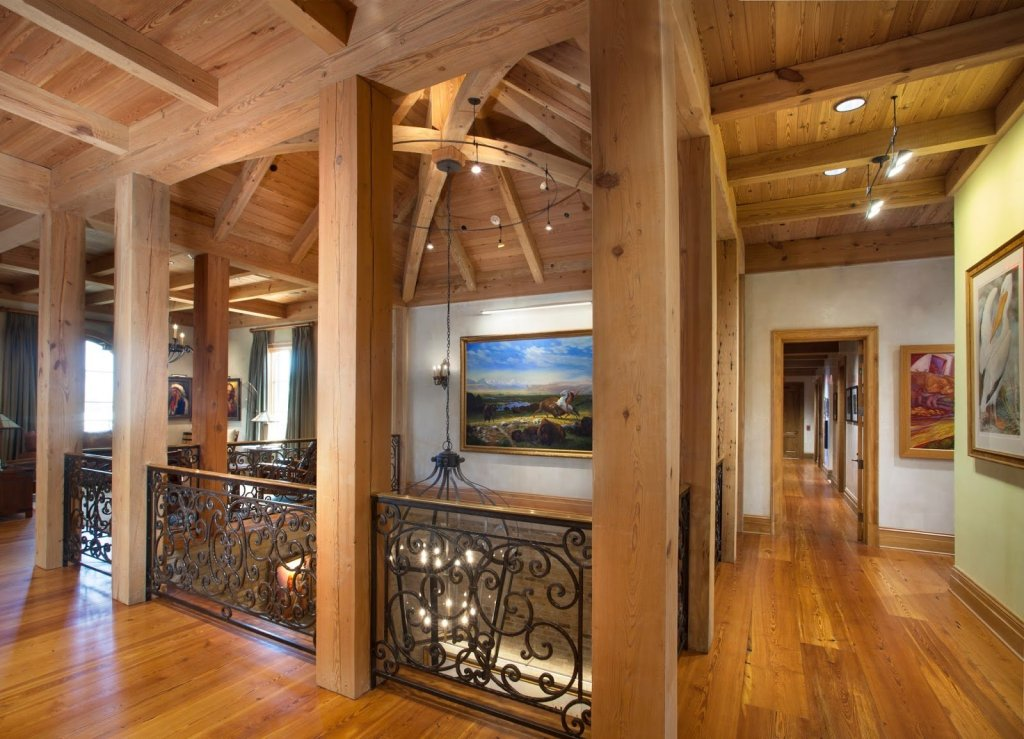 Exposed heart pine beams and reclaimed heart pine flooring