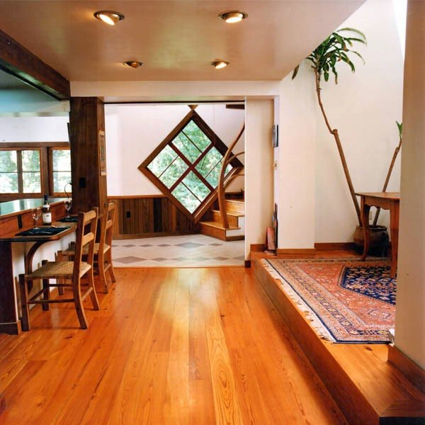 reclaimed heart pine floor sustainable home open floor plan