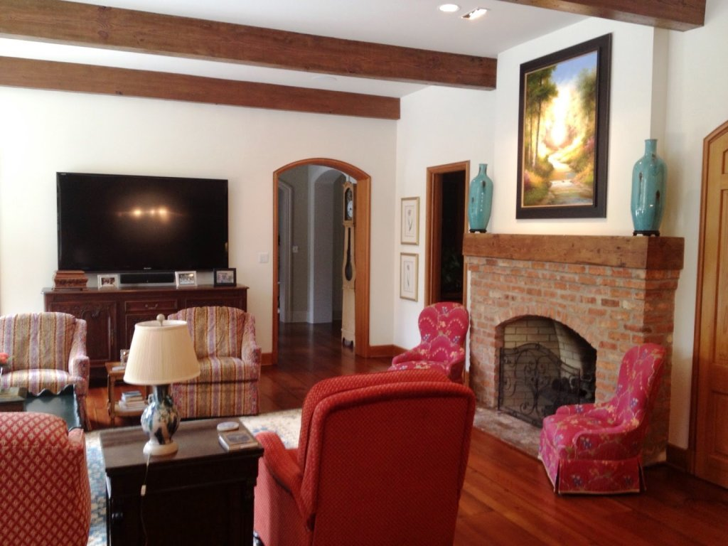 exposed pine beams and beam mantlepiece