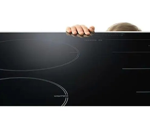 Hand touching induction hob