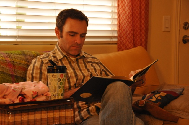 Daddy reading L.L.'s new book from Auntie! We love it, thank you.