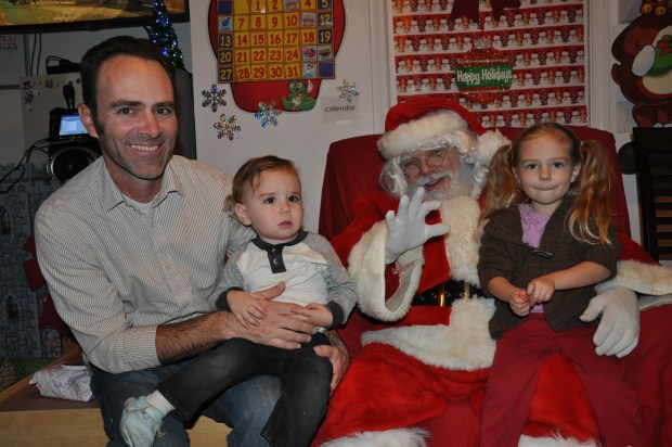 Meeting Santa at school. Cecito was not amused. While LL did GREAT!