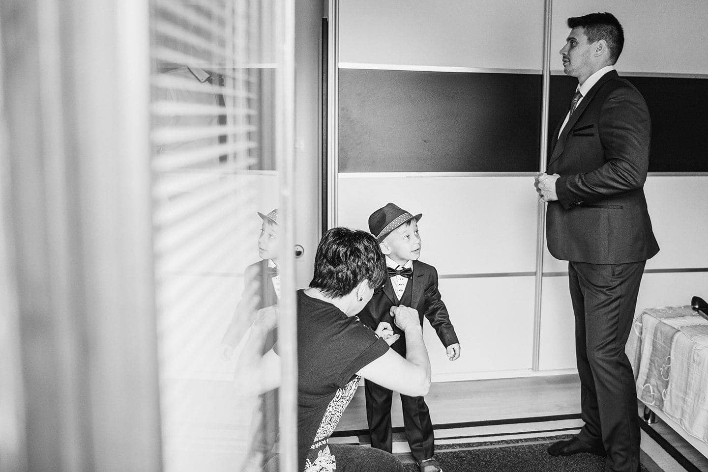 groom getting ready with his son