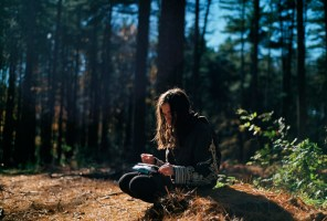 gril in nature with journal
