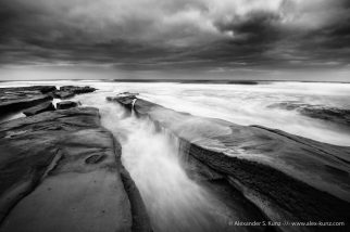 Waves wash over the tide pools at Hospital Point, La Jolla, California. March 2014.