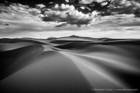 Dispersing monsoon clouds over Algodones Dunes near Glamis, CA. September 2014.
