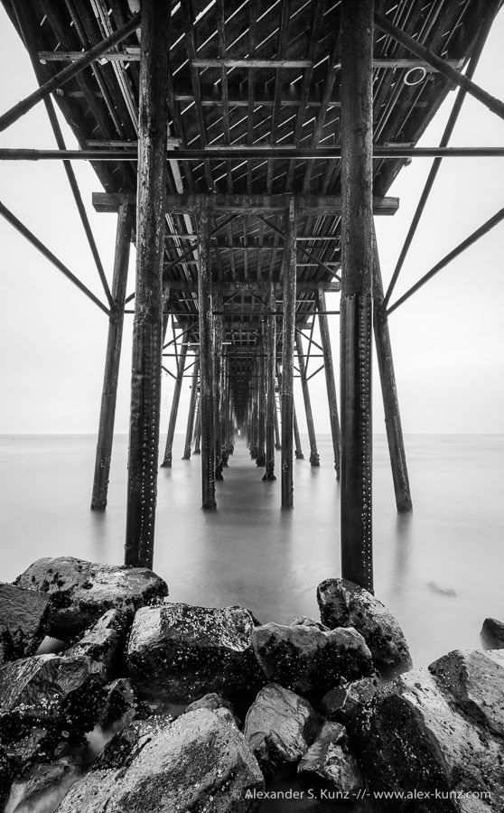 Long exposure photo under Oceanside Pier, Oceanside, California, USA. September 2011.
