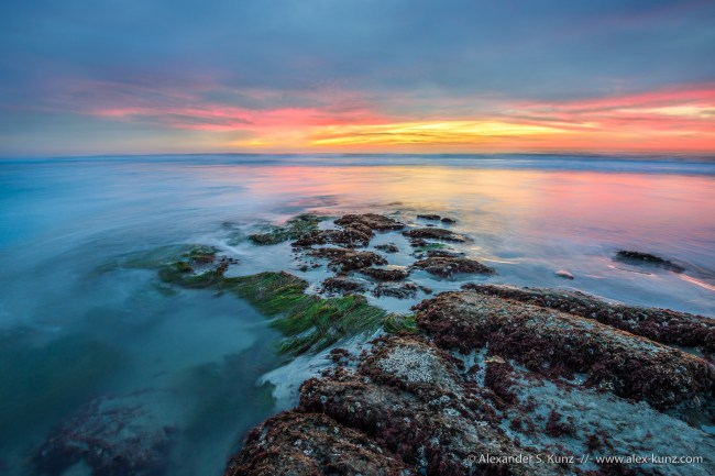 Sunset at Tabletop Reef during negative tide, Seaside State Beach, Cardiff By The Sea, California. December 2014.