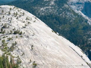 The bare granite slope of Basket Dome seen from North Dome, Yosemite National Park, California, August 2015.