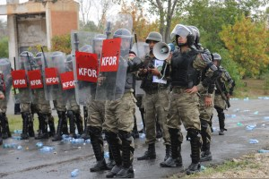 Turkish army Capt. Hakram Ozkubat uses a megaphone to direct his soldiers as they subdue role players posing as rioters   during a crowd and riot control exercise at Camp Vrelo in Kosovo, Sept. 25, 2010.  (U.S. Army photo by Sgt. Joshua Dodds/Released)
