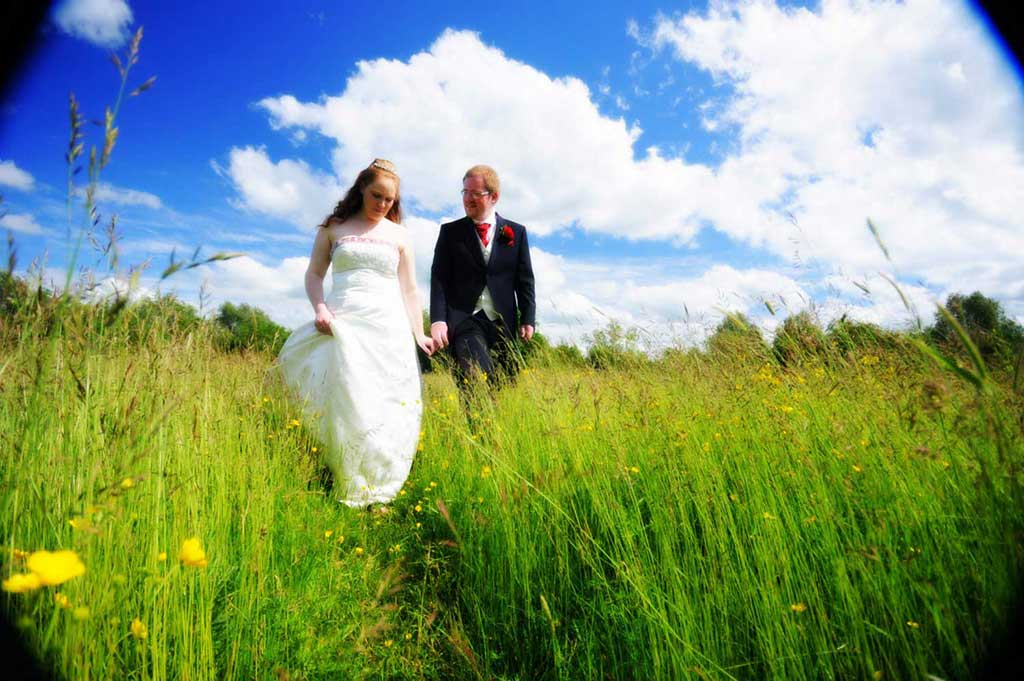 Isaac and Debs had selected a stunning spot for their wedding photos with a beautiful meadow full of wild flowers as their background.