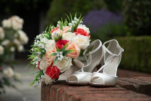 wedding photo showing the detail of the bride's shoes and bouquet