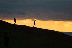 Photo of a couple walking downhill in silhouette