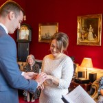 Bride and groom exchanging rings at Horsham registry office