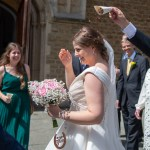 Bride with confetti being thrown at her