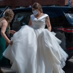 Bride arrives at her wedding wearing a face mask