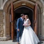 Bride and groom kiss outside the church in Horsham town centre