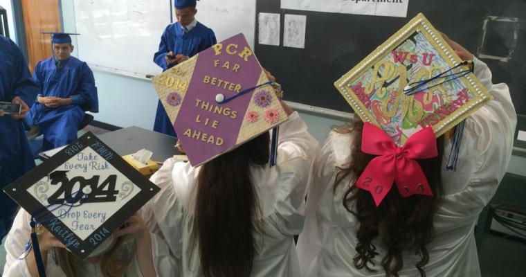 GRADUATES WAVE GOODBYE TO OLD HIGH SCHOOL BUILDING