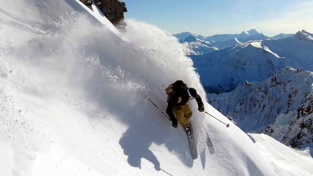 Pro Skier Chris Benchetler slashes through snow in New Zealand Mountains.