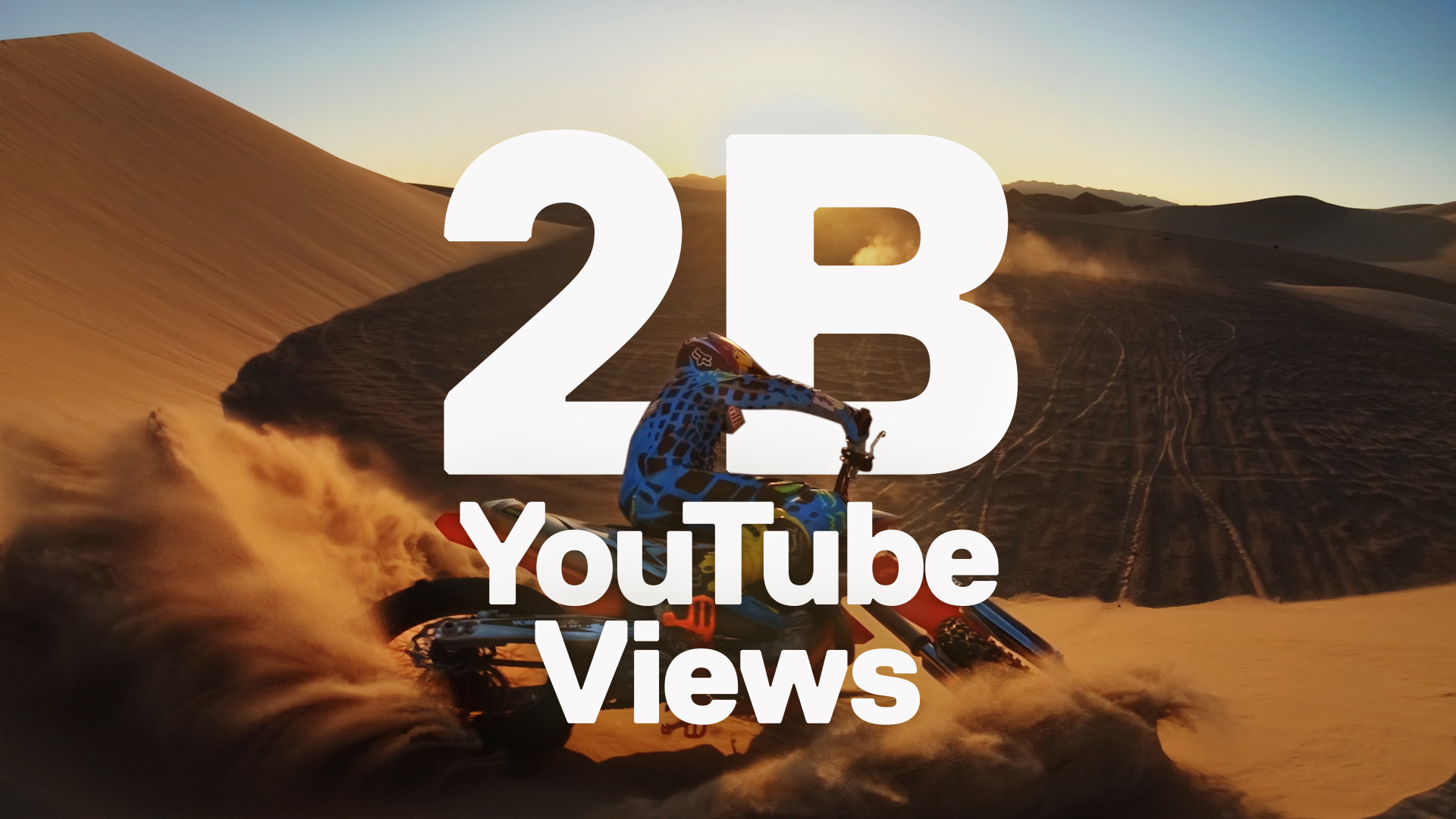 2 Billion Views Graphic with Motorcycle