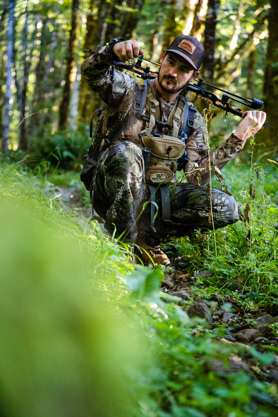 Brandon Nelson checks wind direction while hunting with a bow on production for National TV Series, AdvVANture Hunters.