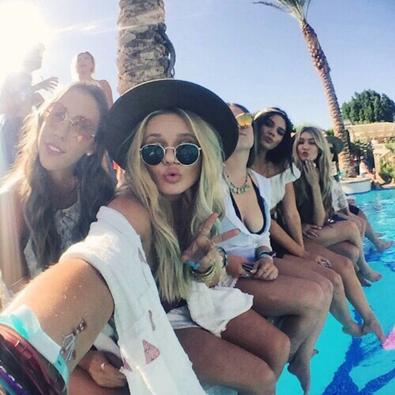 Girls selfie at a beach pool party