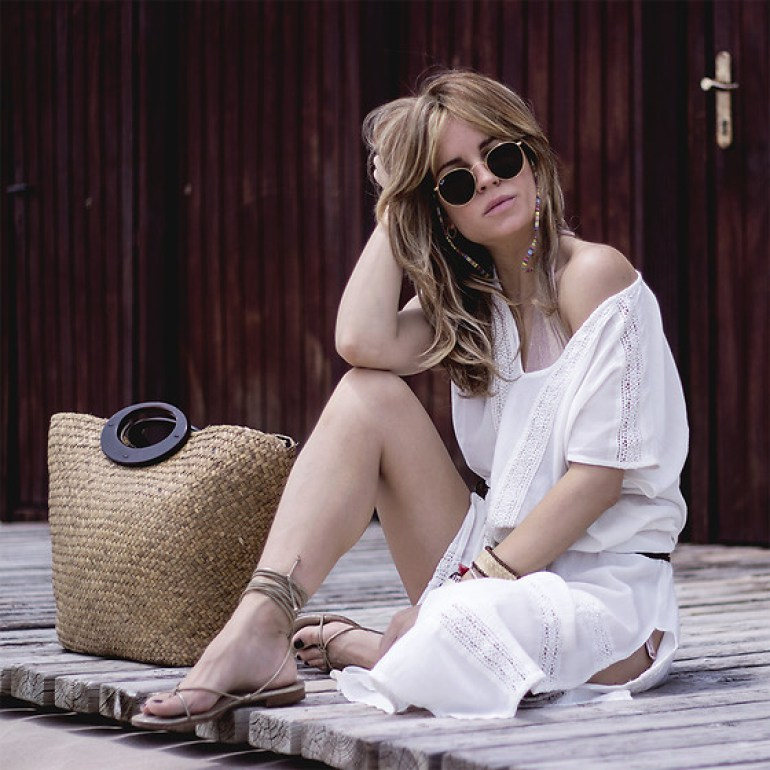 Girl sitting in white beach dress