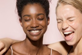 Women wearing BB cream laugh
