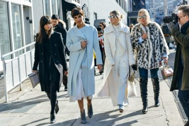 Outfit inspiration for Fall. Models walking down a street in winter outfits