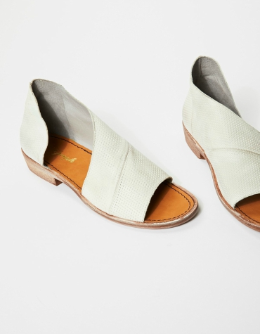 Made with leather, this open toe shoe features side cutouts and a slight stacked heel