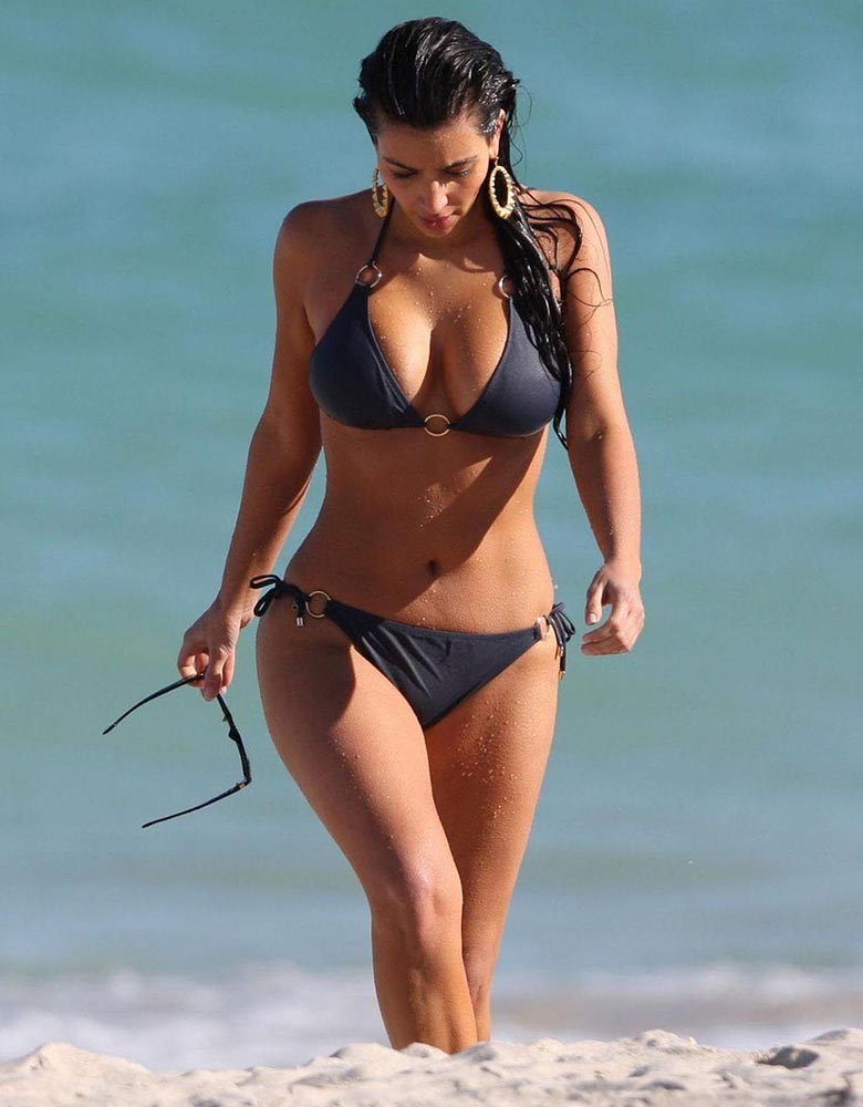 Kim Kardashian wears black halterneck bikini on the beach