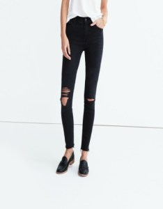 High-rise black skinny jeans with ripped knees