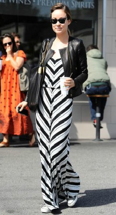 Olivia Wilde in stripe maxi dress with leather jacket and converse