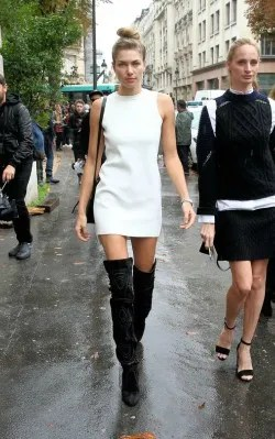 Jessica Hart in white high neck dress with over the knee dark grey boots