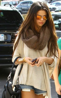 Selena Gomez wearing snood and shorts