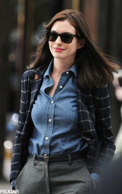Anne Hathaway street style blue shirt, dark trousers and navy blue blazer with stripes - shop the look