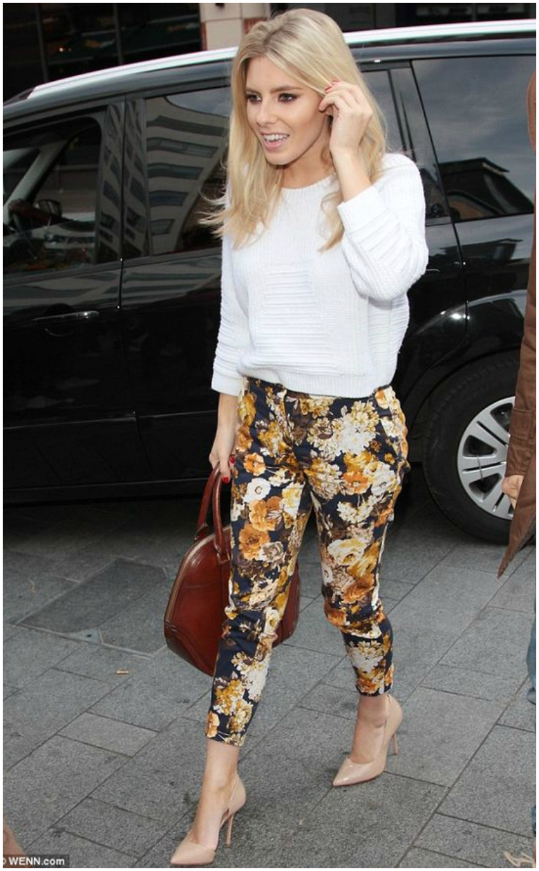Mollie King in white jumper with floral cigarette trousers