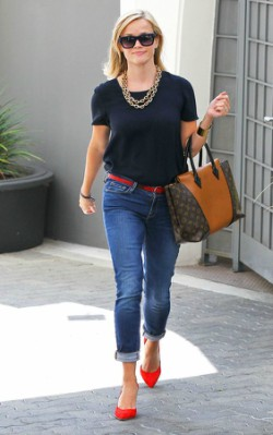 Reese Witherspoon street style polka dot blouse with red shoes and brown and black bag
