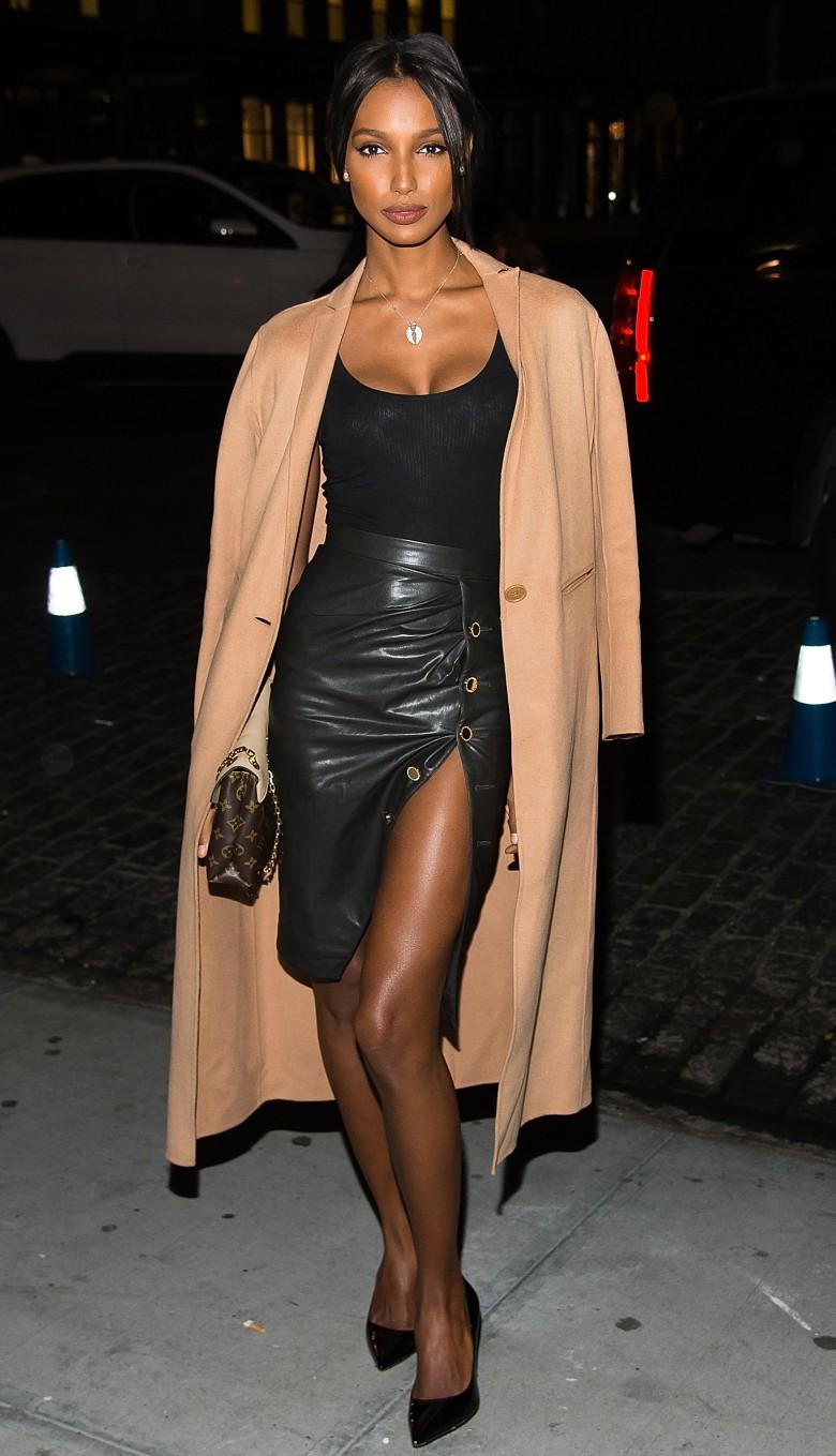 Victoria secret model Jasmine Tookes style - camel coat, black singlet and leather skirt.