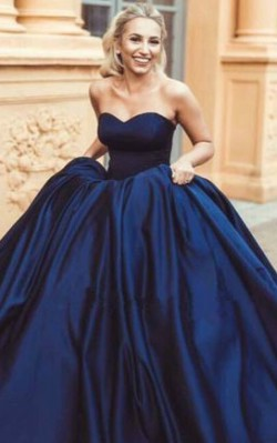 What to wear to a black tie wedding - full length strapless dark blue gown with puffy skirt