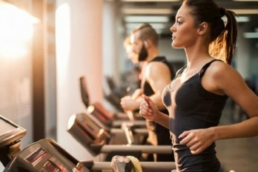 girl running on the treadmill in the morning