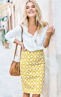 Woman in yellow pencil skirt and white shirt - 50 best pencil skirts