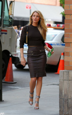 Blake Livley in black pencil skirt, heels and black top