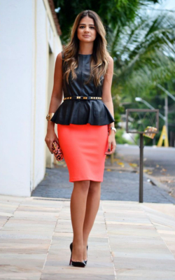 Model in coral pencil skirt and black top
