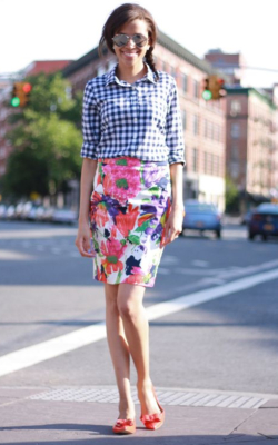 Model in floral pencil skirt and gingham shirt