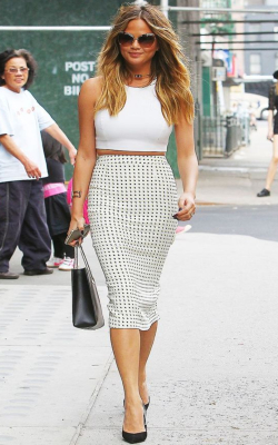 Christine Teigen in black and white print pencil skirt - 50 best pencil skirts